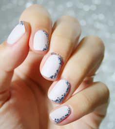 Sprinkle on a little sparkle with this nail art featuring 'marshmallow' and 'a stroke of brilliance'.