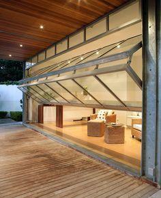 This Breezeway's glass garage doors open onto deck