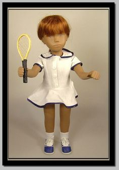 Tennis outfit complete with racquet