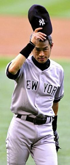 Ichiro doffs his new Yankees cap to fans at Safeco Field Monday night after his trade to New York.