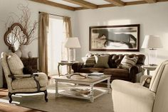 Ethan Allen living room. Love dark rich woods (or cocoa) with creams and other natural earth colors. Like the sofa. Attractive, but also practical. More formal chair on the left is nice too.