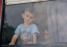ロシア南西部ロストフ(Rostov)の臨時施設にウクライナ東部ドネツク(Donetsk)からバスで避難してきた子ども(2014年6月21日撮影)。(c)AFP/ANDREY KRONBERG ▼27Jun2014AFP|ウクライナからロシアへの避難民11万人 国連発表 http://www.afpbb.com/articles/-/3019055 #Rostov