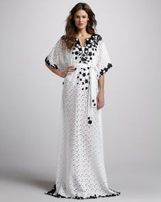 neiman marcus    Oscar de la Renta puts his signature dramatic spin on this collection beach coverup.•Crochet with contrast embroidery.  •Split neckline.  •Half batwing sleeves.  •Self-tie waist.  •Hem falls to floor.  •Polyester.  •Imported.