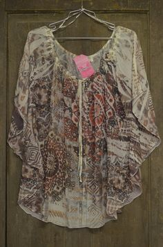 Cowgirl Clad Company - Tribal Print Sheer Top, $18.00 (http://www.cowgirlclad.com/tribal-print-sheer-top/)