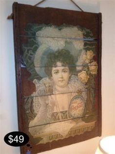 Vintage Coke girl graces wood planks in a frame, Coke art is highly collectible.      Yesterdays Treasures Consignment    5829 Lone Tree Way Suite J    Antioch    925 - 233 - 8549