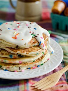 These pretty pancakes are made from a box of yellow cake mix and rainbow sprinkles!
