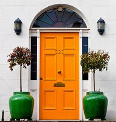 Considering painting the red front door orange. Like the way it looks!