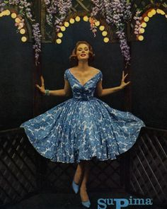 Suzy Parker started work for a modeling agency at age 15 and quickly grew to be a top model. Here is she is modeling a very pretty blue and white 1950's dress. #styleicon and #modcloth
