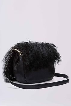 The DVF Love Power Large Saddle Bag is a sleek cross body bag featuring a leather body with suede front flap, a leather strap and gold hardware detail.In mongolian fur.