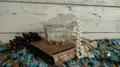 Check out this item in my Etsy shop https://www.etsy.com/listing/125938073/retro-pearl-oyster-lidded-glass-dish