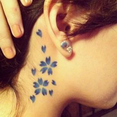 Blue Sakura Neck Tattoo - Cute Cherry Blossom Tattoo Design Ideas, http://hative.com/cute-cherry-blossom-tattoo-design-ideas/,