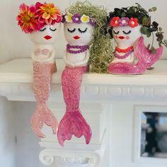 Handmade ceramic mermaid planters.