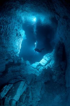 Explorer inside Orda Cave, the biggest underwater gypsum cave in the world, Russia (by samebody). S)