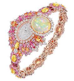Montre Haute Joaillerie Dior Exquise Opale Or rose et blanc 750/1000e, diamants, saphirs roses, saphirs jaunes, opale claire, grenats spessartites, saphirs violets et rubisMouvement quartz - Réf. : JOLY93023