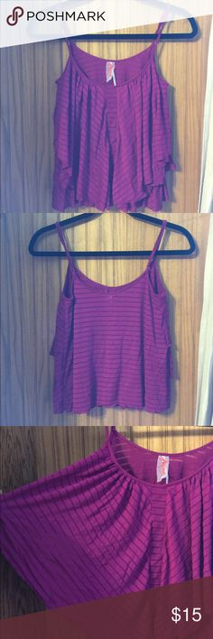 Free people purple spaghetti strap top Condition: Excellent used condition (EUC) Flaws: no flaws Other info:  Measurements : will be listed here and / or photographed measured  laying flat.   ••length (shoulder to hem) :  ••bust (pit to pit):  ••hips:  ••waist: •••STOCK PHOTO TO SHOW FIT ONLY••• * No trades * No try on/models - sorry. * Please submit an offer via offer button * Bundle 3 or more items for 20% off Thanks for looking Free People Tops