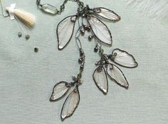 make wire and resin wings inspired by Cynthia Thornton's Woodland Wings necklace - from Freeform Wire and Resin Jewelry: Make Angel Wings, Fairy Wings, Leaves, Flowers and More - Jewelry Making Daily