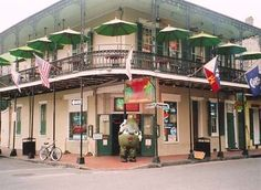 On the NOLA bucket list of many: Tropical Isle, home of the Hand Grenade. Located at the corner of Bourbon and Orleans, this location boasts one of the larger balconies with a view -reported that you can see St. Louis Cathedral.