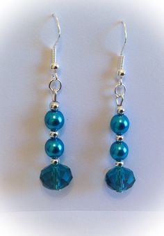 Turquoise beaded earrings with feature faceted glass crystal bead on a sterling silver earring wire..