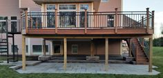 IPE deck with spiral stair case and patio