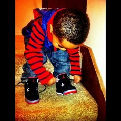 Aawww look how cute & small he is tryna tie his shoe!!