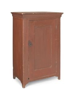 Sold For $4,800 Diminutive Pennsylvania painted pine cupboard, ca. 1820, with a recessed panel door and chamfered corners, retaining an old red surface, 36'' h., 22'' w. Condition report Old metal patch to top , small hole at bottom left of door, nice old dry surface