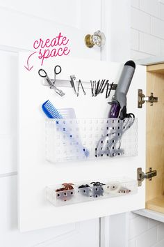 Affix small bins with adhesive strips on cabinet doors to create a home for hot tools, brushes, and hair ties. A magnetic strip keeps bobby pins, nail clippers, and tweezers from getting lost.