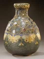 "Amphora~""Sandstone Jewel""~Important vase~Ovoid body and flared sandstone series ""Semiramis"" Iridescent glazes blue~green and gilded relief decorations of insects~Spider webs~cabochon neck Circa 1904-1906"