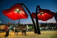 HQ Architects have designed a dynamic street installation in Vallero Square in Jerusalem. A set of giant urban flowers react to different . Flower Lamp, Flower Lights, Plans Architecture, Landscape Architecture, Street Installation, Giant Flowers, Red Flowers, Fabric Flowers, Street Lamp