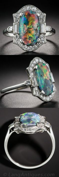 Platinum Black Opal and Diamond Art Deco Ring, A magnificent and mesmerizing Lightening Ridge black opal, shimmers and glows a complete palette of electric colors, fills the center of this chic, Art Deco ring. This enchanting jewel is finely handcrafted in platinum, circa 1925, and is set with a sparkling array of small round, baguette and bullet-shape diamonds.