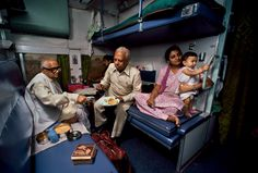 Steve McCurry, INDIA. Calcutta, 1983. A family eats on a train in India.                                                                                                                                                                                 More