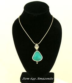 A Lovable small Amazonite Stone in a simple setting to Magnify it's Beauty This Item was SOLD