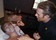 Mortician makeup before    http://www.necromorphous.co.uk/communities/3/004/008/586/733/images/4540463487.jpg