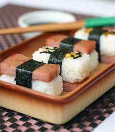 spam musubi - this was sold in the school cafeteria for lunch daily. I never ever ate this.