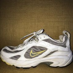 Nike tennis shoes Used white, grey, and yellow nikes great condition  Nike Shoes Athletic Shoes