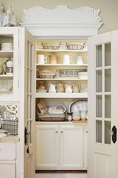Shabby Chic Farmhouse Home Decor - a closet becomes a pantry with built-in cabinets, drawers and open shelves - via Midwest Living Fresh Farmhouse, Shabby Chic Farmhouse, Shabby Chic Homes, Farmhouse Sinks, Vintage Farmhouse, Kitchen Pantry, Kitchen Decor, Kitchen Design, Kitchen Ideas