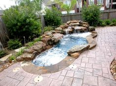 Backyard too small? Not for a swim spa. This unique body of water can be heated in a very short period of time to allow for year around enjoyment. Hydro massage spinning jets are located above a multi-level seating bench for therapeutic needs. Signature Pools of Texas are designed to compliment the home's exterior as well as the interior. Fiber optic lighting has been added in the waterfall for a dramatic effect while enjoying the pool's view from inside the home…especially while…