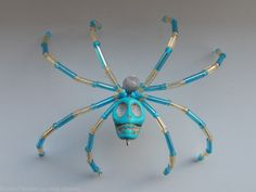Saratoga Springs, NY but the stated link is no longer operational. Wire Spider, Pet Spider, Skull Jewelry, Beaded Jewelry, Jewellery, Christmas Spider, Christmas Holiday, Diy Crafts Jewelry, Wire Crafts