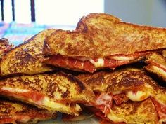 Pizza Grilled Cheese: 4 slices of bread buttered, 4 slices of mozzarella cheese, pepperoni, Italian seasoning or basil, Parmesan cheese, pizza sauce for dipping... Could do these in our pie irons while camping