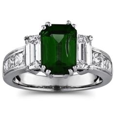 3.56 carat total weight 3-stone ring featuring a 1.65 carat emerald cut emarald center, 1.05 carat total weight prong set emerald cut diamonds, and .86 carat total weight channel set princess cut diamonds in 14k white gold. Dear future husband- if you get me this ring i will marry you