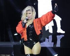 All that glitters: Fergie couldn't resist adding a touch of feminine glamour to her ensemble with a range of glitzy bomber jackets in shades of burnt orange and green