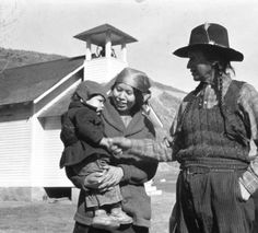 "San Poil chief Jim James with Nettie Francis holding child, ""Ceremony of tears"", Kettle Falls, Washington, 1939 :: American Indians of the Pacific Northwest -- Image Portion"