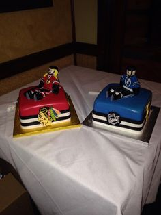 Rehearsal cakes..the bride is a die hard Blackhawks fan and the groom is a Lightening fan < sigh >