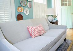 Bright living room with stylish but neutral sofa via Year of Serendipity