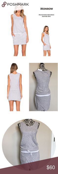 ✨NWT Monrow Heather Grey Drawstring Mini Dress✨ Brand NWT by Monrow, MSRP $158. Great to wear anytime, casual comfy cotton mix dress. Adjustable drawstring at waist in contrast color (white/off white) as well as 2 slide slant pockets in contrast color for maximum comfort! Tank style sleeves, scoop neck. Dress is unlined-as shown in photos top half of dress is thinner than skirt section and could be a tad sheer (depending on how tight it's worn). See pic 5 skirt half is doubled over at hem…