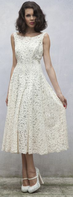 I have been having trouble finding a tea length dress that has a shape and fit that I like. This one fits the bill! I'd like some mint colour beneath the lace and/or a colourful sash.