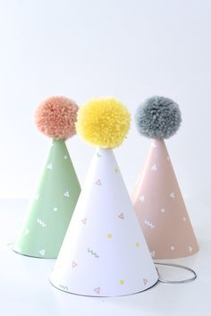 Party hats with pom-poms from Happy Balloons Birthday Party at Kara's Party Ideas. See it all at karaspartyideas.com!