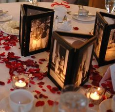 I'm SO doing this!! so adorable!! <#   -  Picture frames glued together with no back and a flameless candle behind - pictures printed on vellum. What a cute way to personalize the centerpieces for a reasonable price!