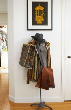 Get rid of that old boring coat rack and use something like this. Their sold everywhere these days in a variety of colors. Love it