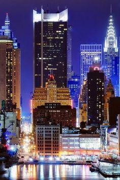 NYC. 45 E Street  at night from Hamilton Park, Union City, NJ, looking East