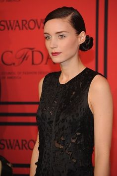 Rooney Mara pulled her hair back into a tight, low chignon and wore a deep red lipstick, which has become a classic beauty look for the actress.